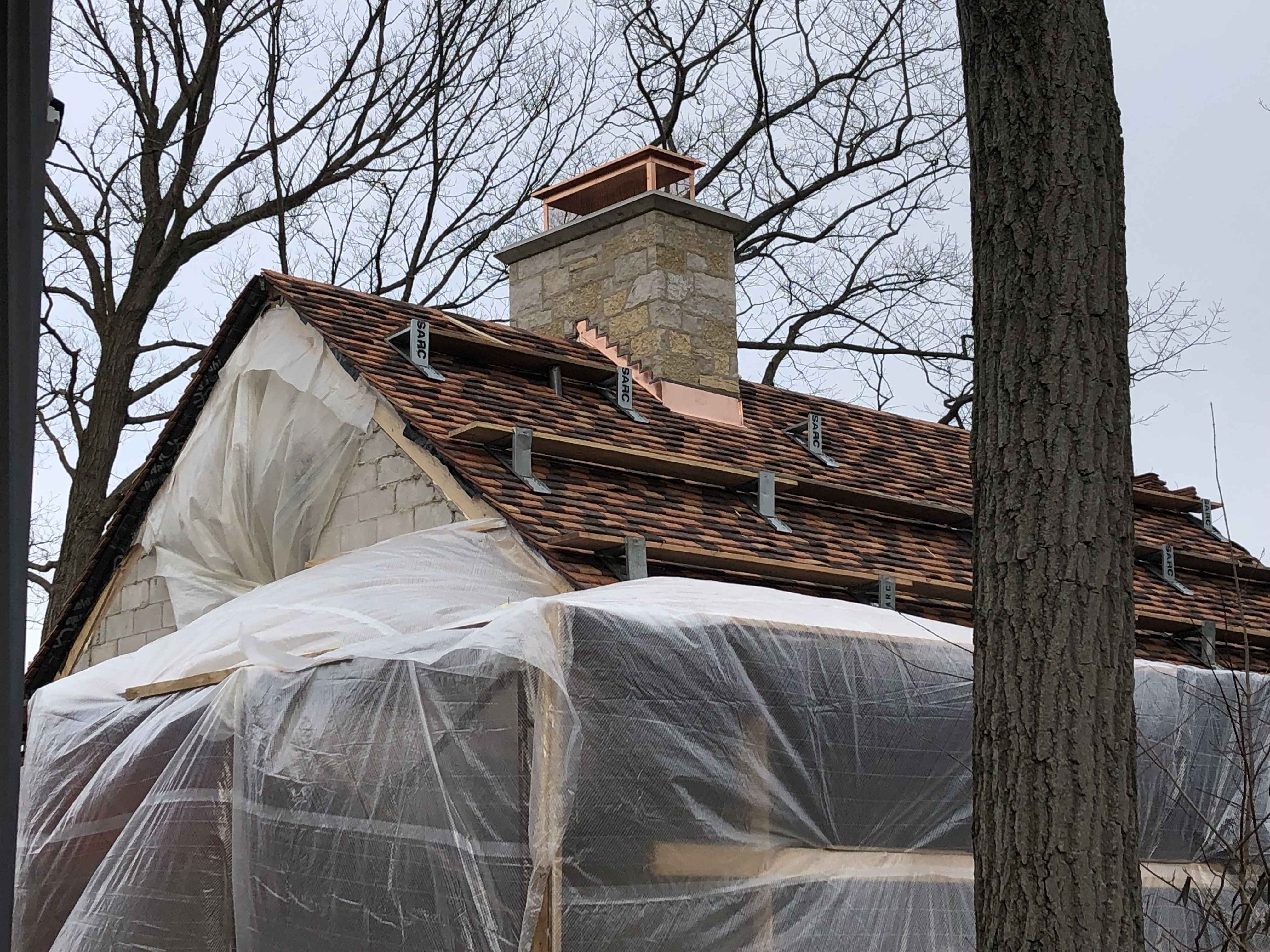 Tile Roof with Copper Accents
