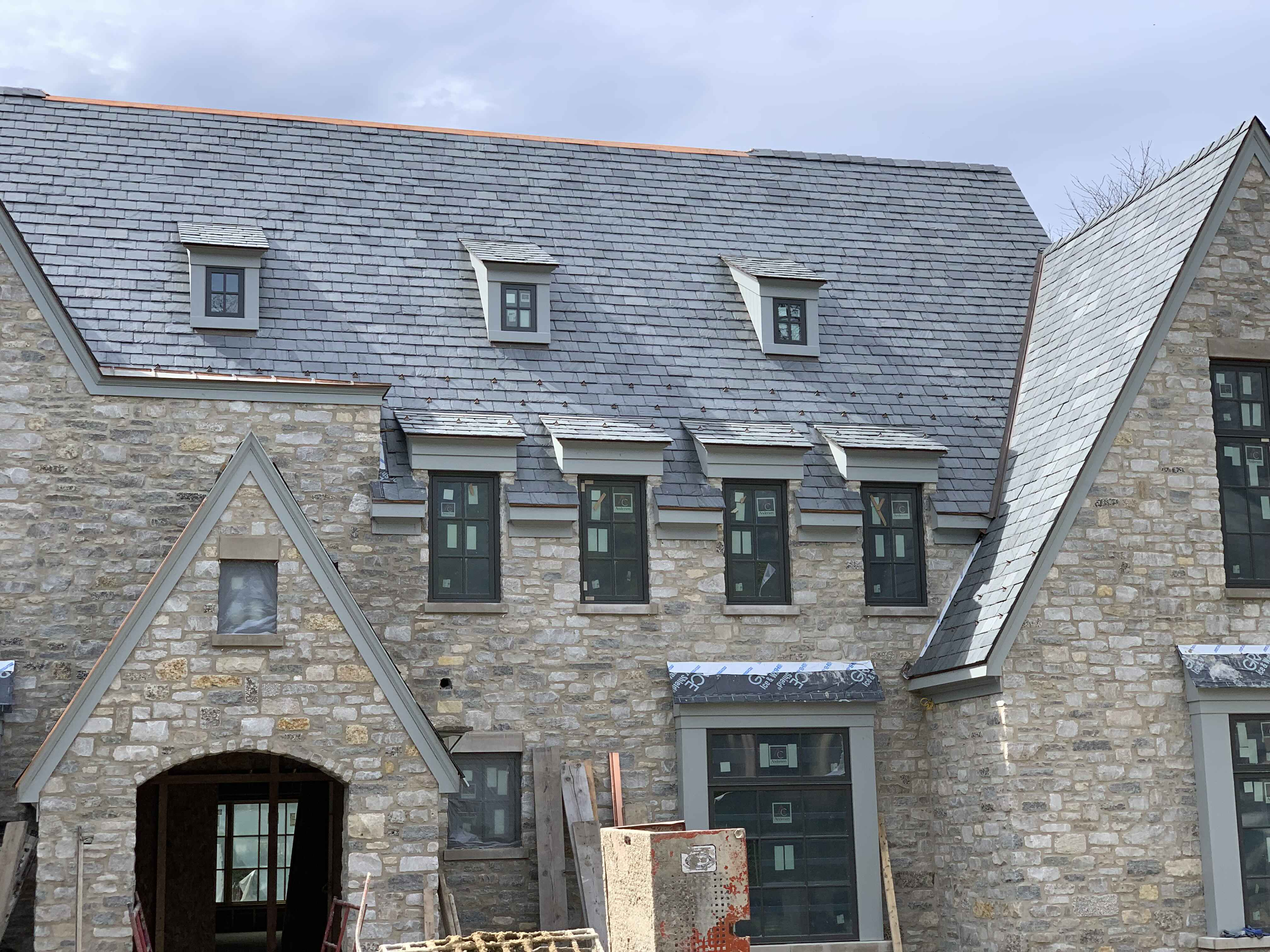 Traditional Slate Roof with TPO Flat Roof
